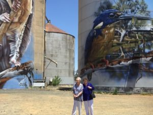 Bev and Judy in front of the painted silos in Rochester